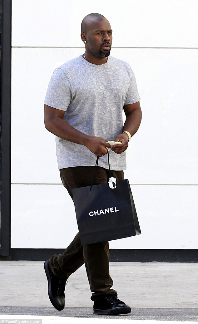 Kris Jenner's beau Corey Gamble leaves Chanel with a gift in hand